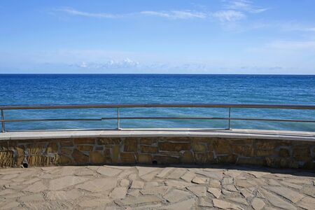 Empty sea promenade, stone wall