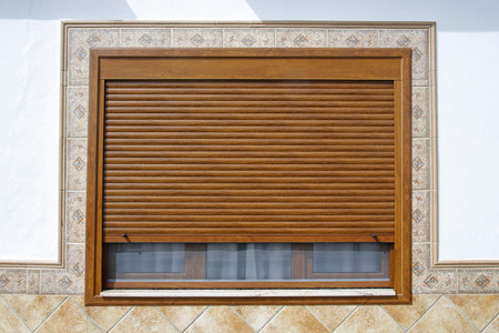 Wooden window with blind