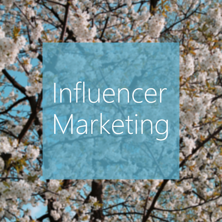 Influencer Marketing concept, spring blooming tree in the background