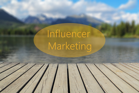 Influencer Marketing text, mountain lake in the background