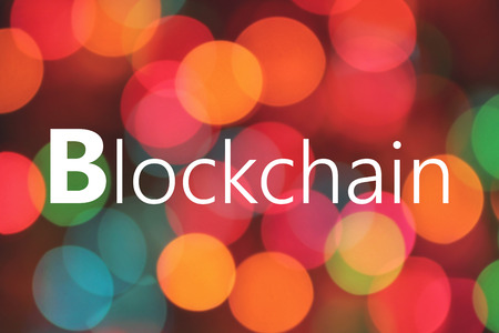 Blockchain written on colorful bokeh background Banque d'images