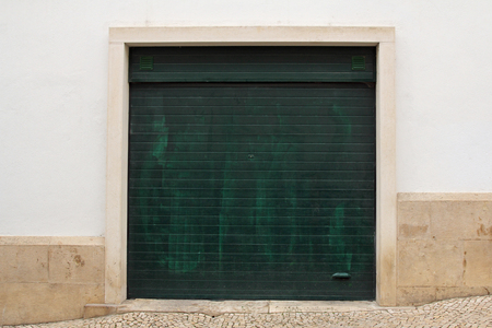 Green garage door Stock Photo