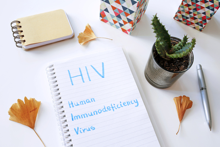 HIV Human Immunodeficiency Virus written in notebook on white table