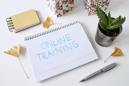 online training written in a notebook on white table