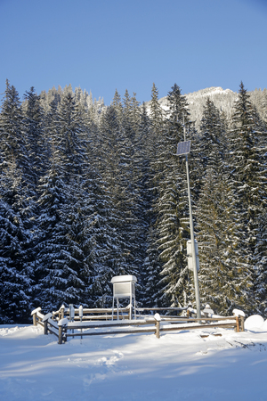 meteorological observatory station in the mountains at winter