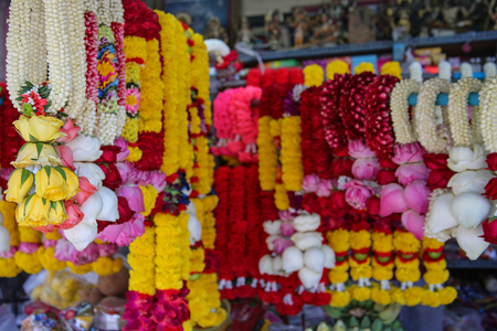 Indian colorful flower garlands for sales at street stall