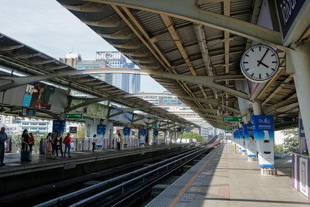 Bangkok, Thailand, march 5, 2019: people waiting at BTS Sky train station Ratchadamri in Silom district