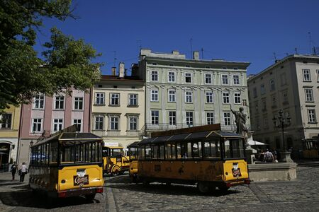 Lviv, Ukraine - june 3, 2019: sightseeing train in front of City Hall on Market Square in Lviv