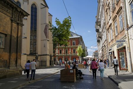 Lviv, Ukraine - june 1, 2019: tourists walking on colorful Halytska Street in direction to Market Square in Lviv