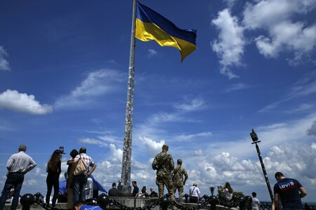 Lviv, Ukraine - june 2, 2019: people and flag waving on the top of the Union of Lublin Mound. Its located on the summit of Lviv High Castle in Lviv Redakční