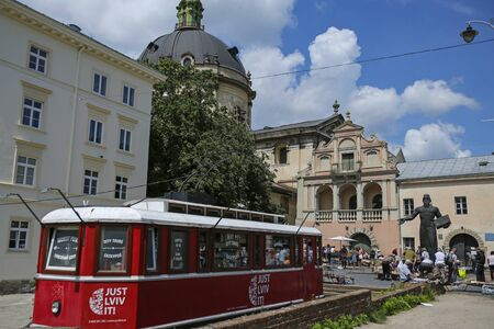 Lviv, Ukraine - june 2, 2019: old  book market under monument to Ivan Fedorov near Dominican Cathedral in Lviv