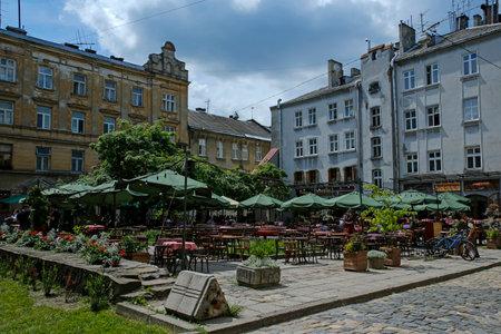 Lviv, Ukraine - june 2, 2019: outdoor restaurants on beautiful Starowieyska street, next to Lviv Arsenal Redakční