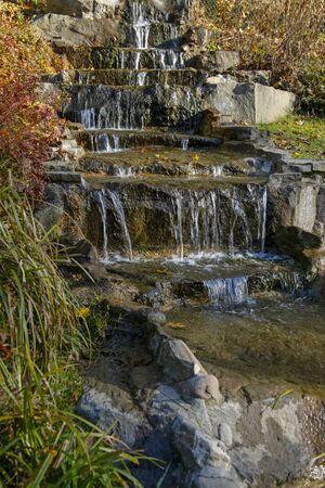 closeup of waterfall in an autumn park