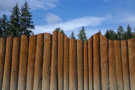 wooden fence against blue sky Stock Photo