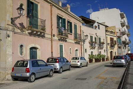picturesque sea promenade in Ortigia, oldest part of the beautiful baroque city of Syracuse in Sicily, Italy