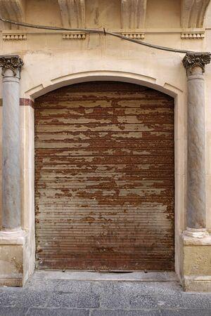 rusty shutter in an elegant wall