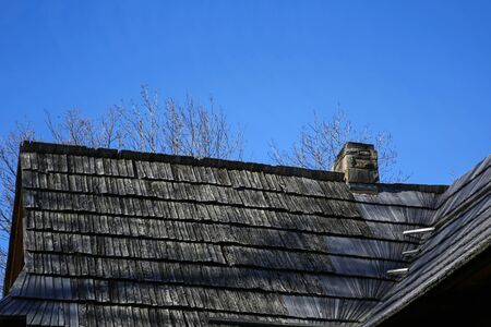 shingle roof and stone chimney