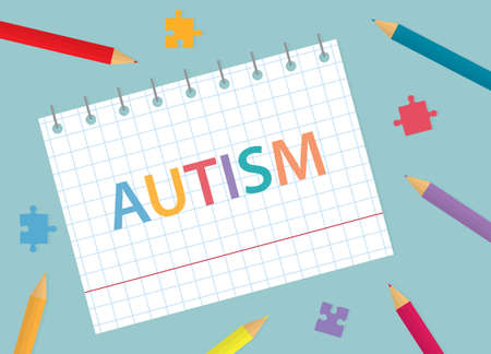 autism written in notebook with colorful pencils and puzzle pieces- vector illustration Vectores