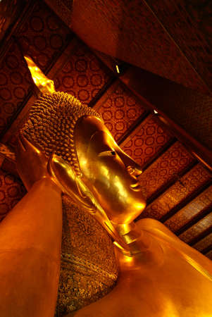 Fiant sleeping buddha statue taken in Bangkok, Thailand photo