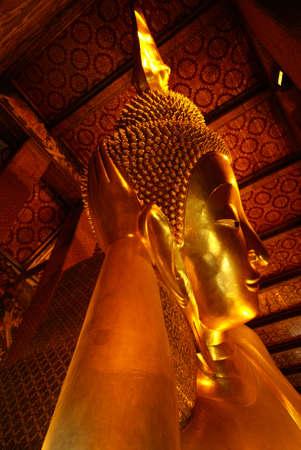 Fiant sleeping buddha statue taken in Bangkok, Thailand photo