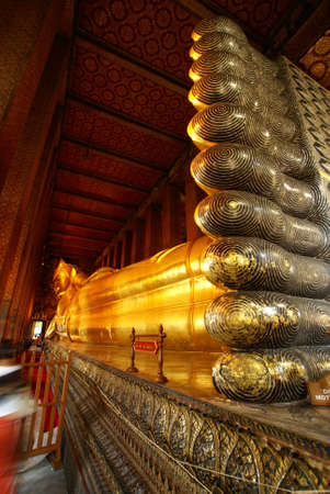 Giant sleeping buddha statue taken in Bangkok, Thailand photo