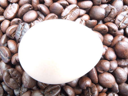 spreaded: Roasted coffee bean spreaded with a white egg  Stock Photo