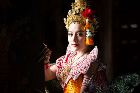 Beautiful Thai young woman portrait in Kinnaree traditional dress costume Art culture Thailand Dancing in masked khon Kinnaree in literature amayana, thailand culture Khon, Ayuttaya, Thailand .