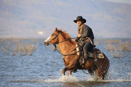 cowboy and horse at first light,mountain, river and lifestyle with natural light background.