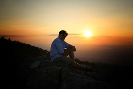 a man on a mountain top. Person on the rock. Sport and active life concept. Beauty world.