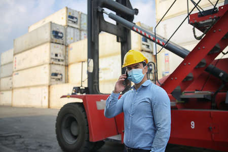 Factory industry worker working with face mask to prevent Covid-19 Coronavirus spreading during job reopening period .