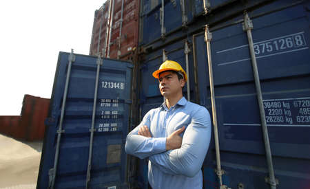 Foreman control loading Containers box from Cargo freight ship for import export. Stock fotó