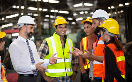 group of workers, change of workers in the factory, people go in helmets and uniforms for an industrial enterprise