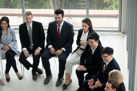 Shot of a group of businesspeople having a discussion in an office