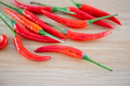 trompo de madera: Red Chillis on wooden top