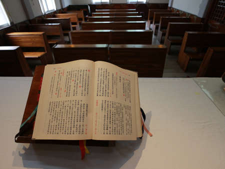 Chinese version of the Bible with wood pews in the church.In Asia Editorial
