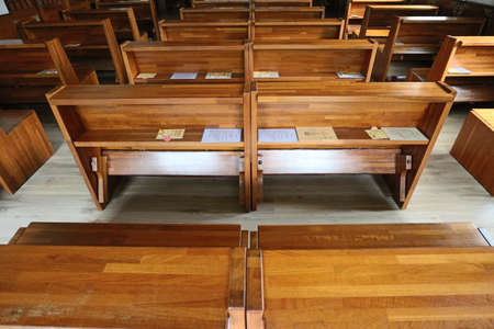 Wood pews in the church. In Asia.