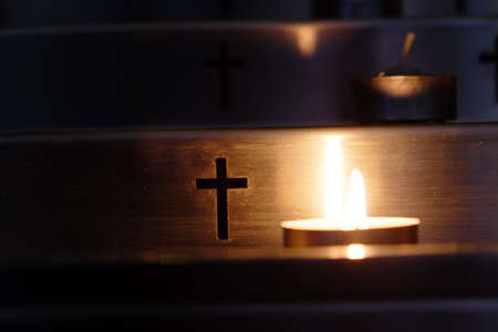 Metal candlestick. Imagery about prayer, death, heaven, faith. Фото со стока