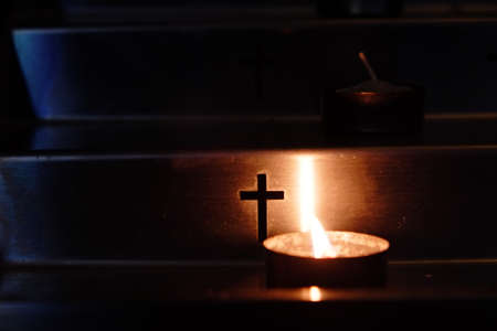 Metal candlestick. Imagery about prayer, death, heaven, faith. 스톡 콘텐츠