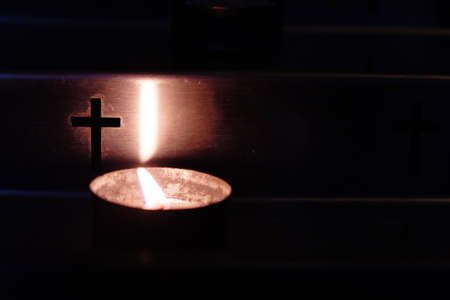 Metal candlestick with candle in the church. Close up. Stock Photo