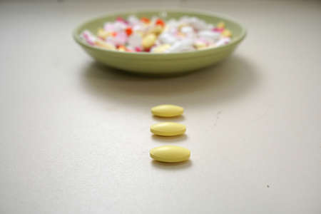 Many different color medicines are placed on the plate.