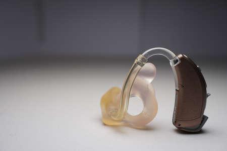 Hearing aid on white isolated background. Deaf ear aid. Redakční