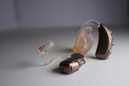 Hearing aid on white isolated background. Deaf ear aid. Foto de archivo