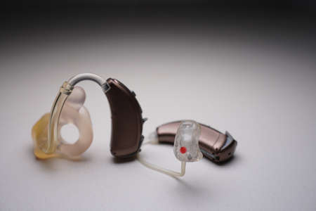 Hearing aid on white isolated background. Deaf ear aid. Stock Photo