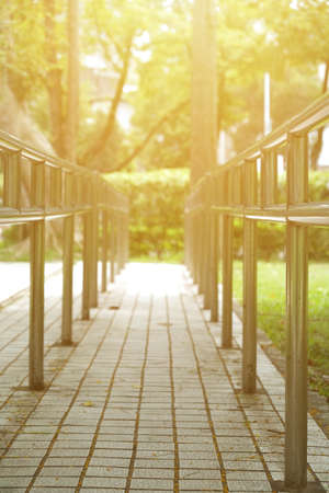 Sunny day, railing of rehabilitation in the park. vertical photo. No people. Stock Photo