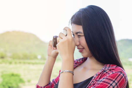 Young hipster woman photographer holding a vintage camera. Stock Photo