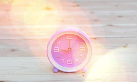 alarm clock with abstract nature bokeh blur background.
