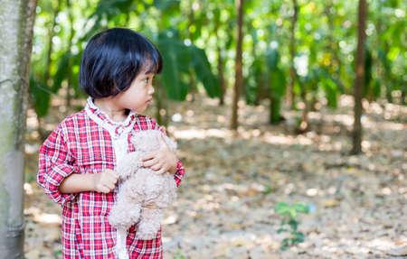 Girl embracing teddy bear Stock Photo