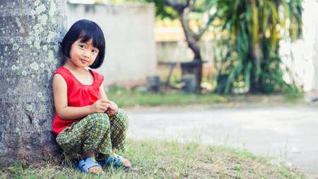 Sad girl sits alone