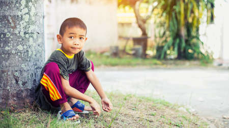Sad boy sits alone Imagens