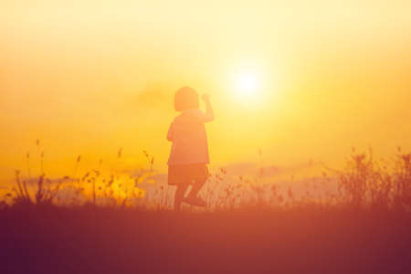 kid silhouette,Moments of the childs joy. On the Nature sunset